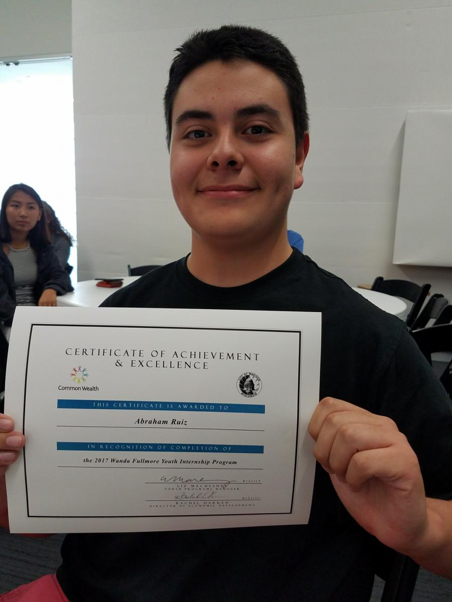 Abe Ruiz with certificate of achievement