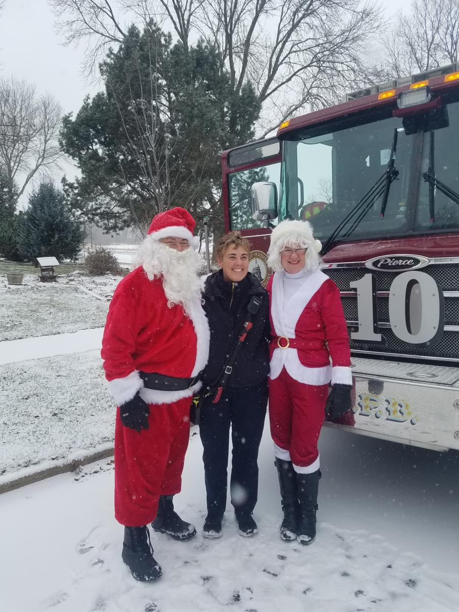 Lt. Lisa Becher with Santa and Mrs. Claus