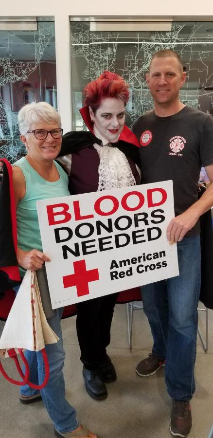 Blood Donors with American Red Cross sign