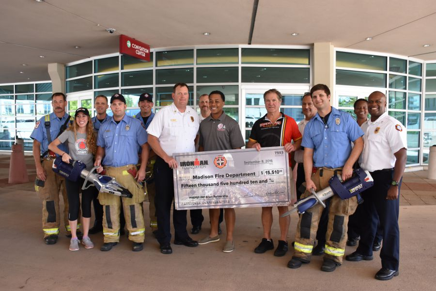 MFD personnel with giant check