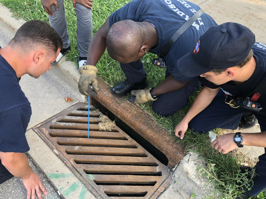 E10 retrieving cell phone from sewer