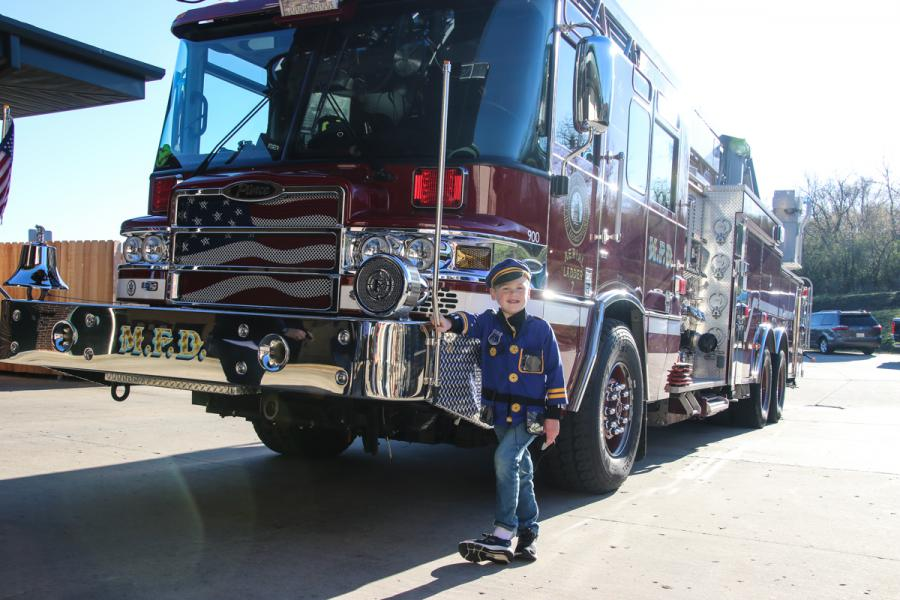 Noah Sanger in front of Ladder 7