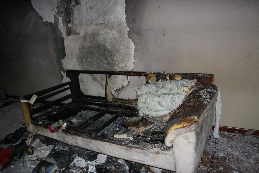 Fire patterns and damaged couch