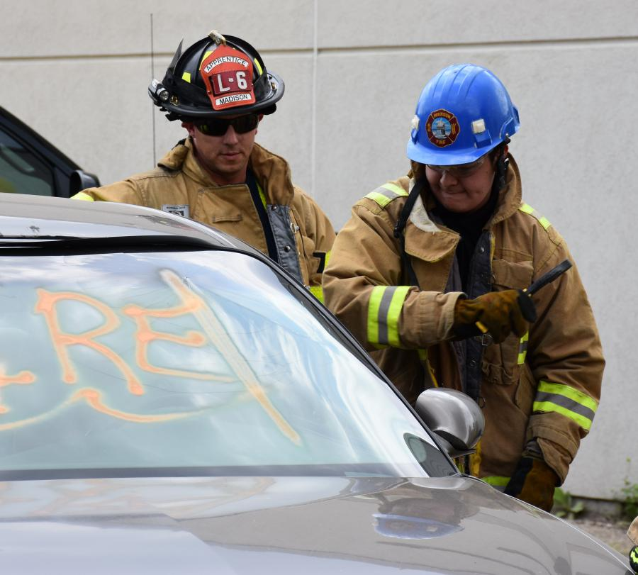Abe Ruiz breaks a car window during an extrication exercise