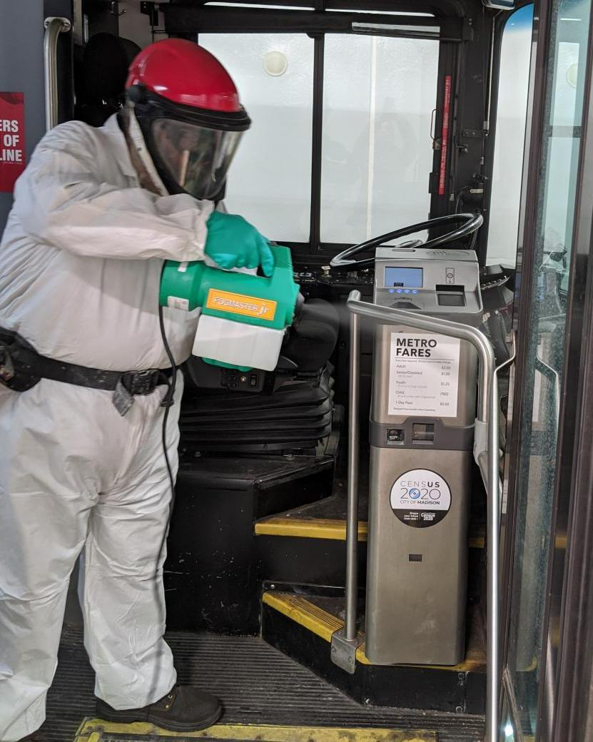 Metro employee disinfecting a bus.