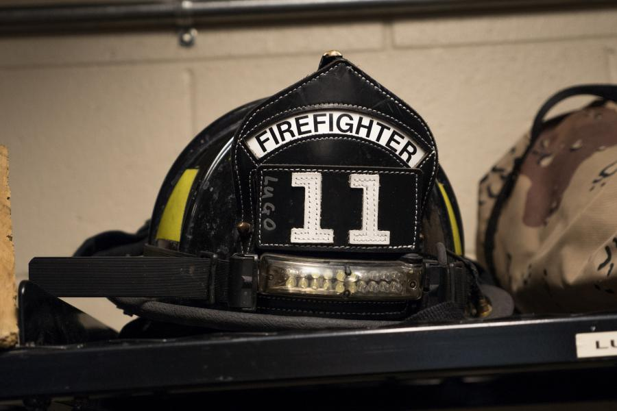 Fire Helmet - Engine Company 11 is comprised of four firefighter/EMTs.