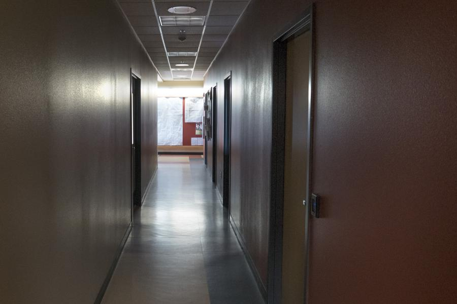 Fire Station 12 - A long corridor leads firefighters from their sleeping quarters to the kitchen and workout room.