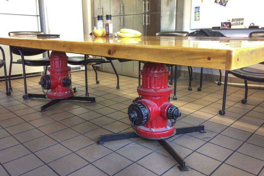 Kitchen Table - Repurposed fire hydrants make up the legs of this handmade, customized kitchen table.