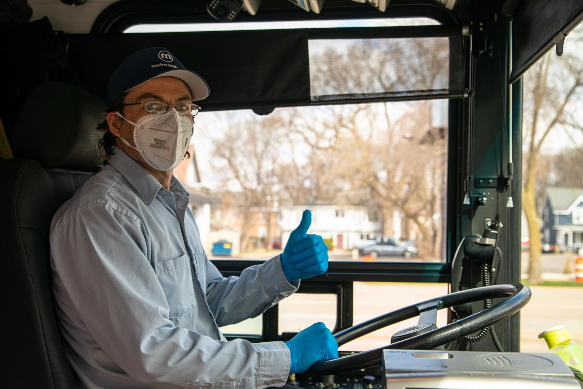 Metro driver wearing a face mask