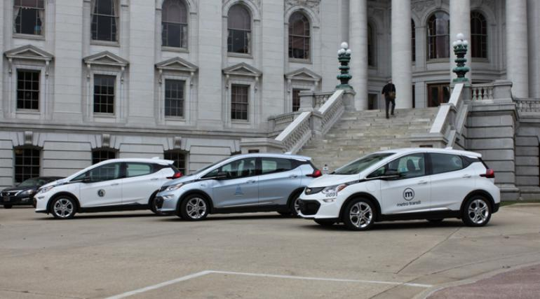 three Chevy Bolts in front of Capitol