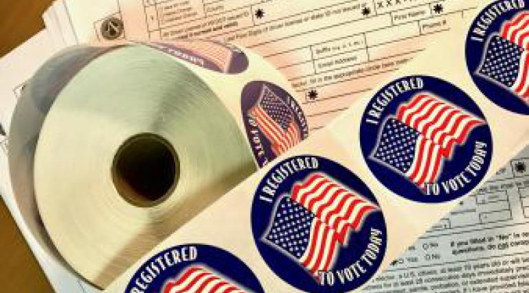 I Registered to Vote stickers and voter registration forms