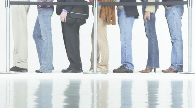 Image of people 5 standing in a line from waist down.