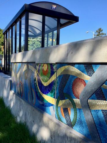 Image of mosaic wall with bus shelter