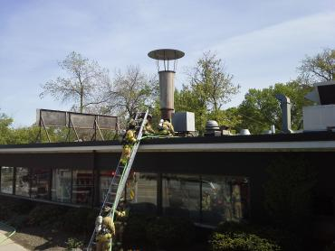 MFD firefighters advance hoseline to roof