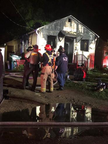 Firefighters at Memphis Avenue Home