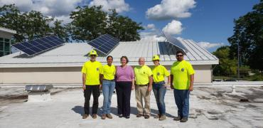 Mayor Satya Rhodes-Conway, City Engineering Division Staff, GreenPower Staff on the roof of Goodman Maintenance Facility