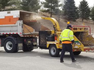 Wood chipper chipping wood. Collection begins April 6. Expect delays.