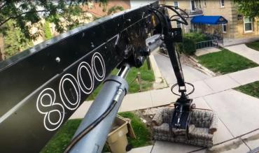 View from the crows nest of a truck mounted crane while collecting a couch