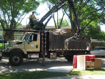 Truck mounted crane collecting items