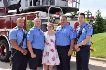 Tori Smith with Lt. Adrian Smith, AE Paul Poker, FF George Ferguson, and Paramedic Kyle Homan