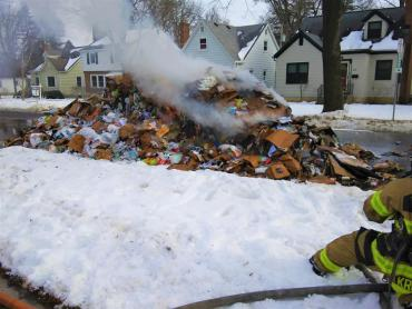 Pile of recyclables burning in the street near intersection of Lucia Crest and N. Blackhawk Ave