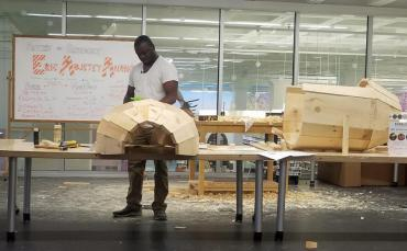 Eric Adjetey Anang working on coffin at MPL's Bubbler makerspace