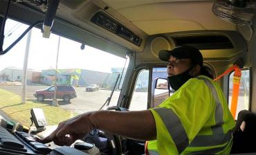 Streets Division operator driving a collection truck