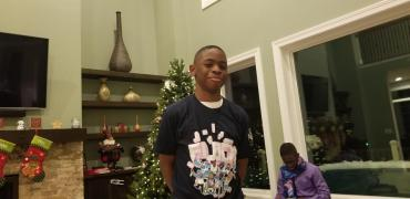 12-year-old Tikeh Tazeh decked out in his new Flock gear