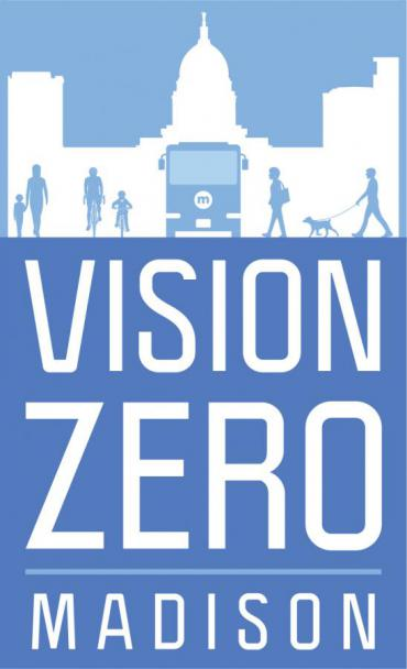 Image of Vision Zero Logo, Blue and white, showing figures and bus.