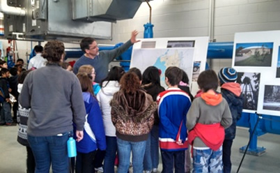 Kids from Crestwood Elementary tour a water well